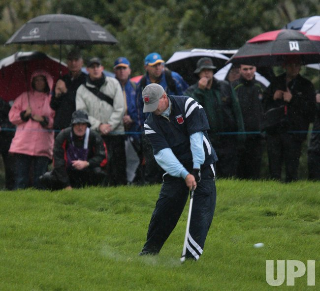Stricker plays in the rain on the first day of Ryder Cup.