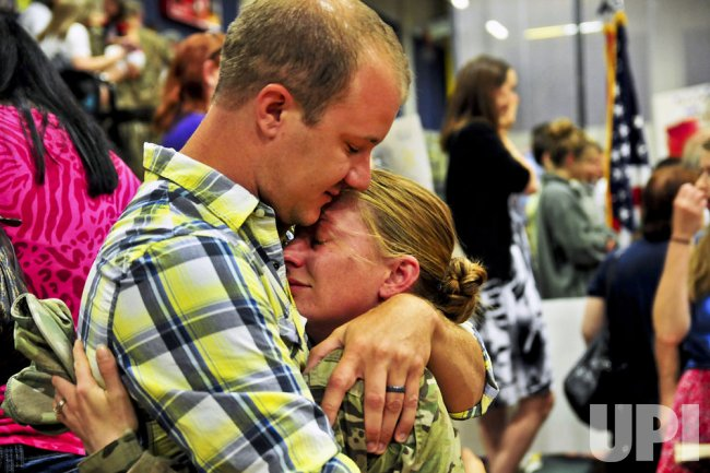 A husband's enduring hug for Operation Enduring Freedom soldier