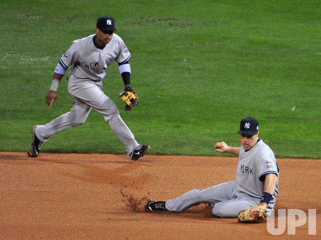 Yankees' Mark Teixeira fields a ball during Game 3 of the World Series in Philadelphia