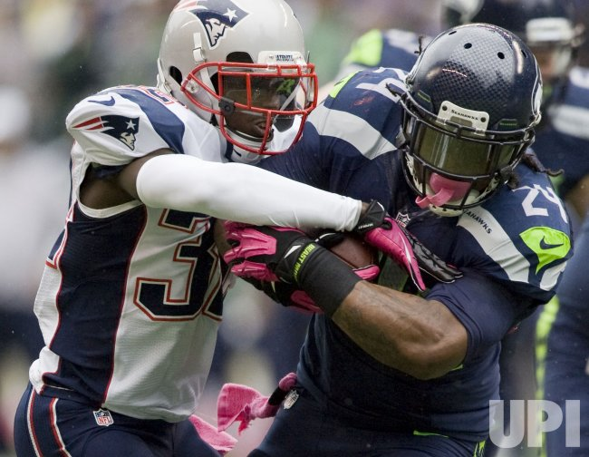 The Seahawks rallied for 14 points in the final quarter to stun the New England Patriots 24-23.