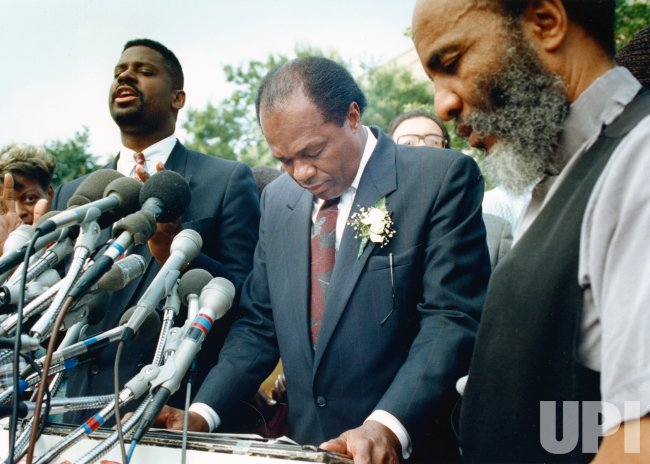 DC Mayor Marion Barry prays with supporters outside the U.S. District Court