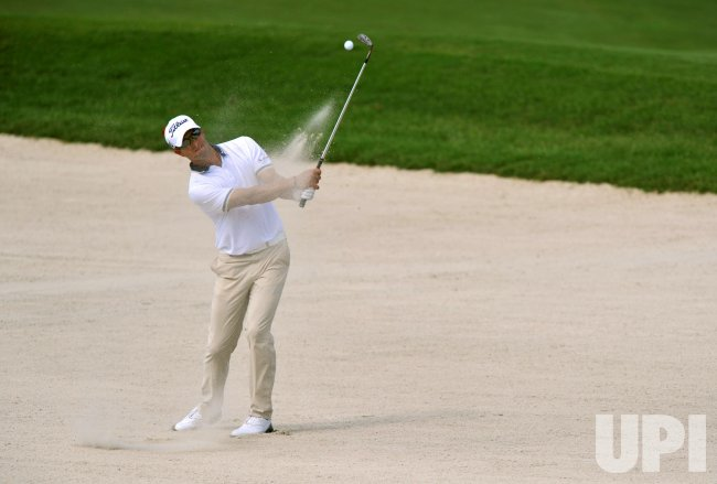 Adam Scott hits a shot from a fairway bunker during the TPC Players in Florida