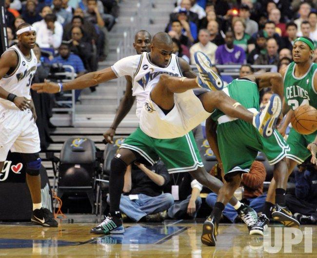 Wizards Jamison run down by Celtics Rondo in Washington