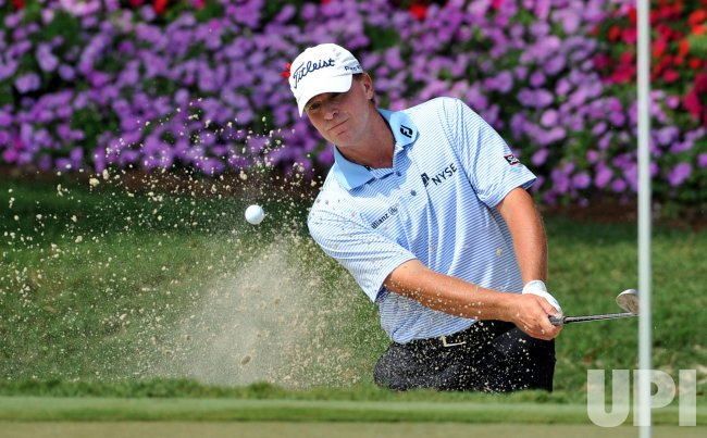 Steve Stricker hits a shot from a bunker during the TPC Players in Florida