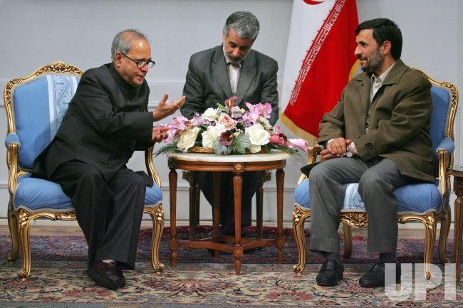 Iran's President Mahmoud Ahmadinejad meets Indian Foreign Minister Pranab Mukherjee in Tehran.