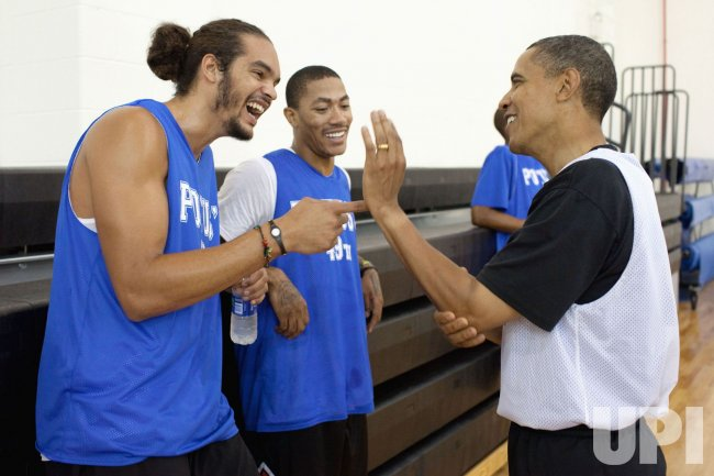 President Obama plays basketball with Chicago Bulls players Joakim Noah and Derrick Rose in Washington