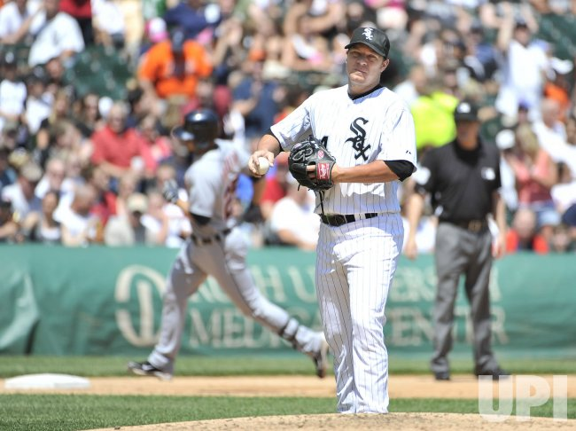 White Sox Peavy reats to Tigers' Raburn's grand slam in Chicago