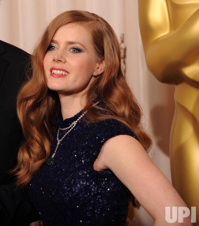 Amy Adams appears backstage at the 83rd annual Academy Awards in Hollywood