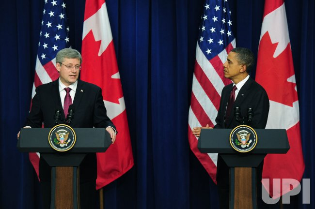 President Barack Obama holds a joint press availability with Canadian PM Stephen Harper in Washington