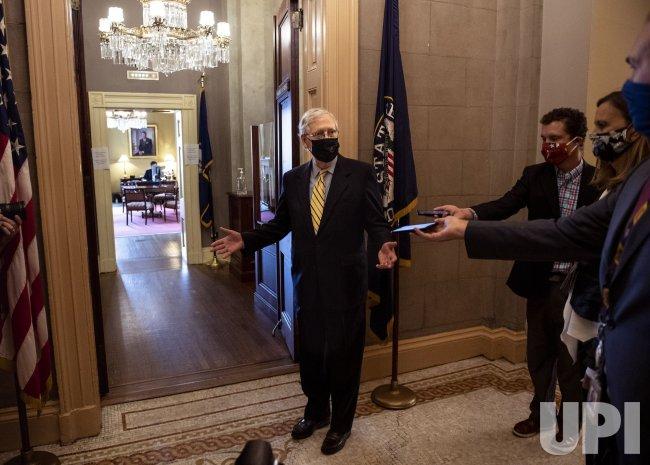 Senate Leader Mitch McConnell leaves Senate COVID Relief Vote on Capitol Hill
