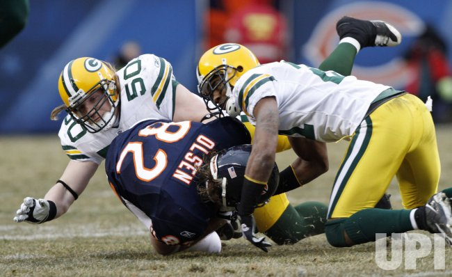Packers' Hawk and Woodson tackle Bears' Olsen in Chicago
