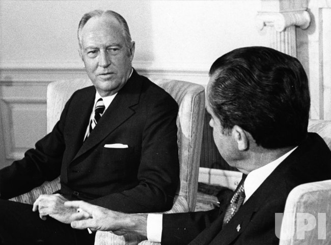 Secretary of State William Rogers briefs President Nixon on his Middle East fact finding tour