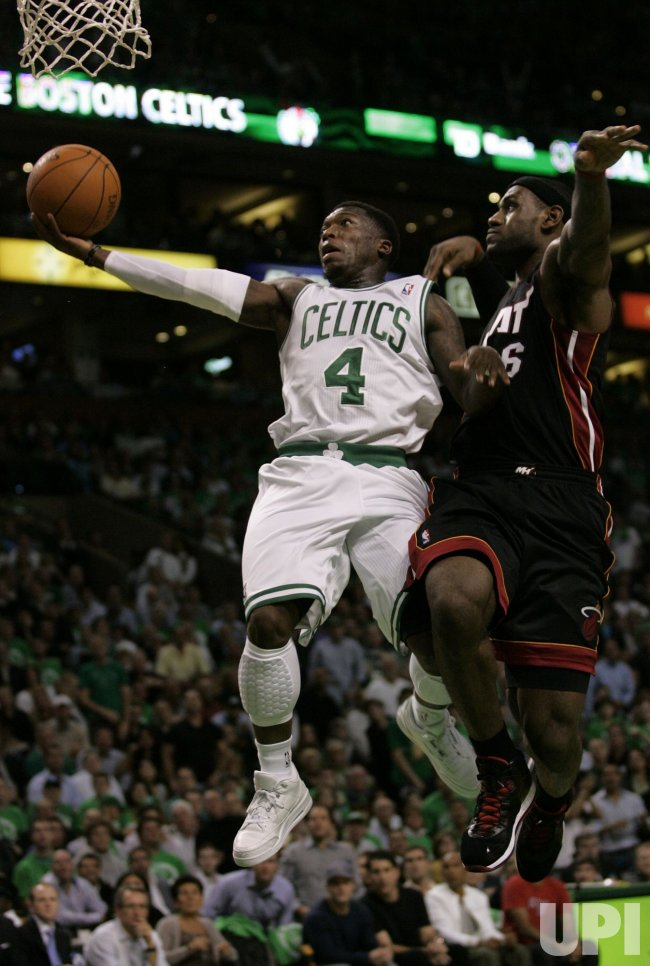 Celtics Nate Robinson attempts shot against Miami Heat's Lebron James in Boston, MA.