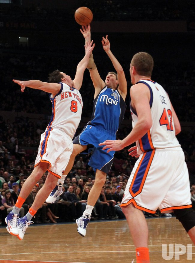 New York Knicks Danilo Gallinari tries to block a shot taken by Dallas Mavericks Dirk Nowitzki at Madison Square Garden in New York