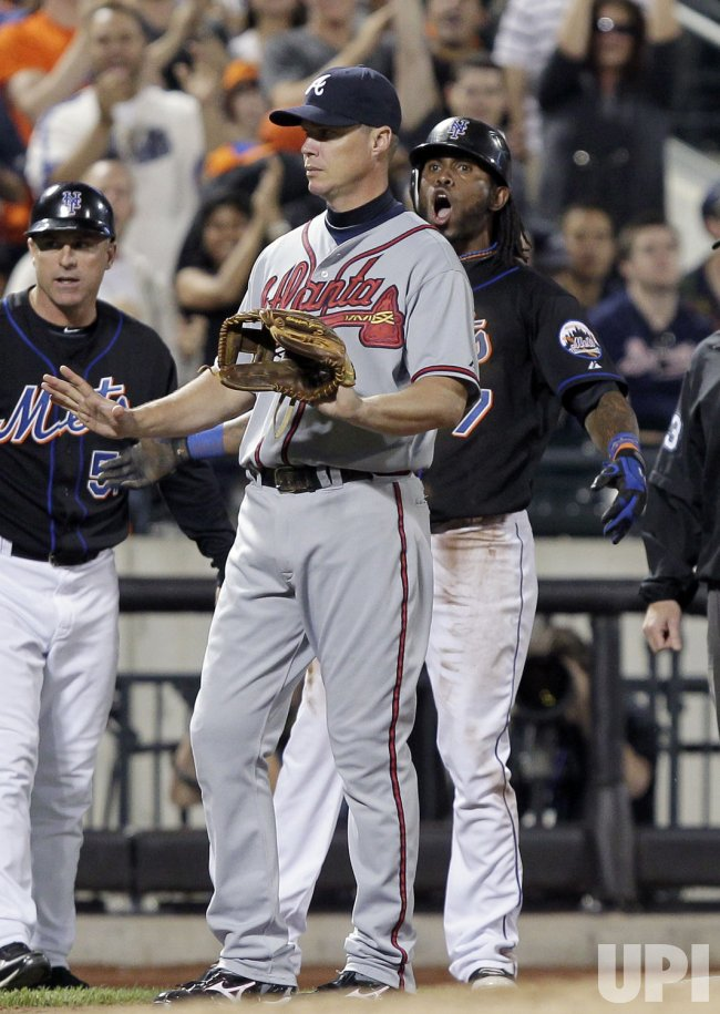 New York Mets Jose Reyes reacts next to Atlanta Braves Chipper Jones at Citi Field in New York