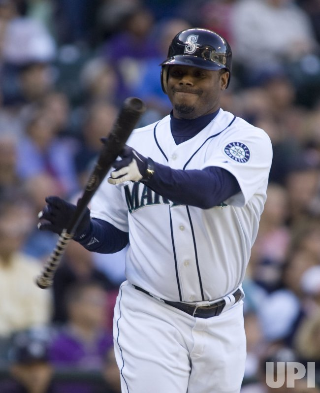 Seattle Mariners' Ken Griffey Jr., tosses his bat in game against the New York Yankees.