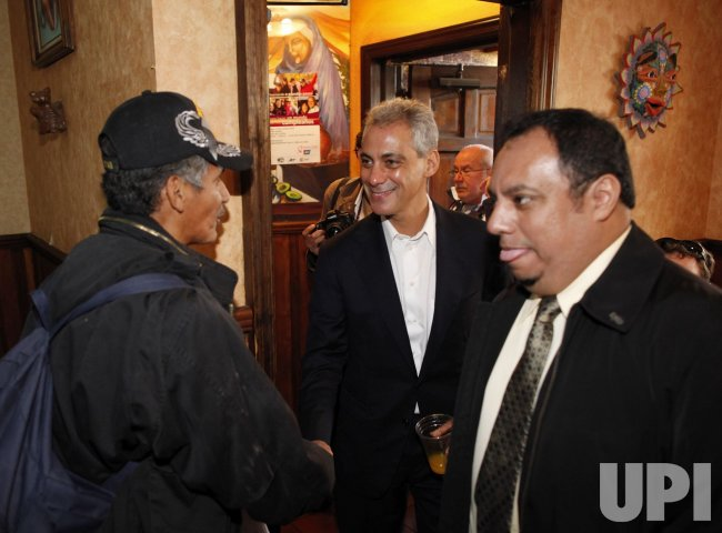 Emanuel shakes hands at restaurant in Chicago