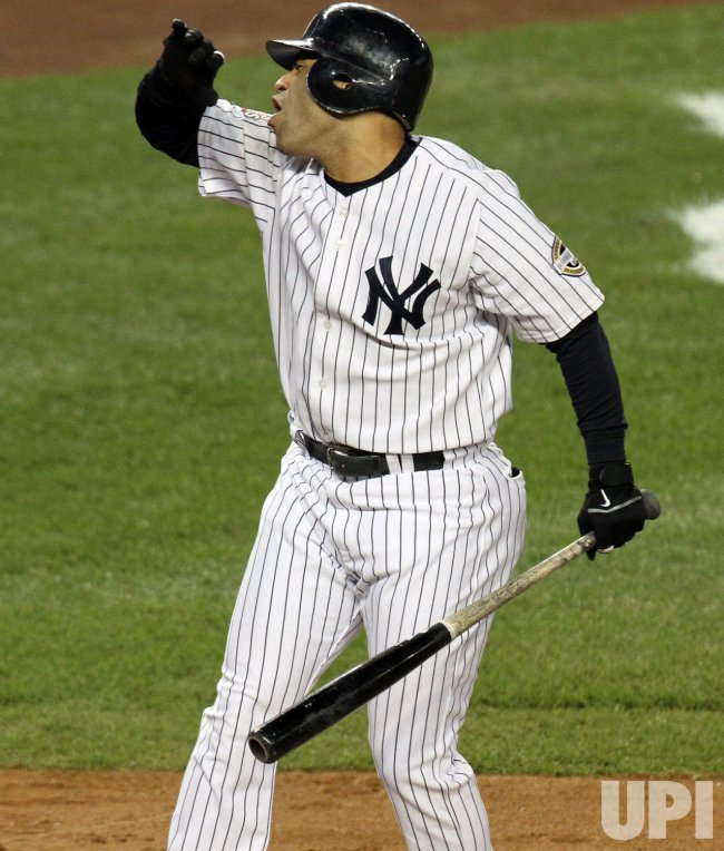 New York Yankees Jerry Hairston Jr. reacts after striking out in the fourth inning against the Philadelphia Phillies in game 2 of the World Series at Yankee Stadium in New York