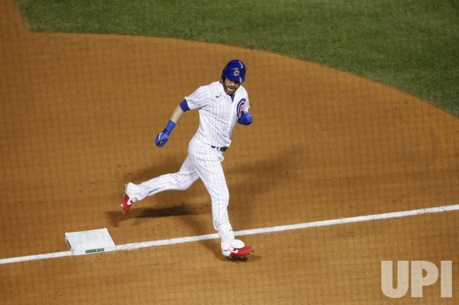 Cubs Jason Kipnis rounds the bases after hitting a solo home run at Wrigley Field in Chicago