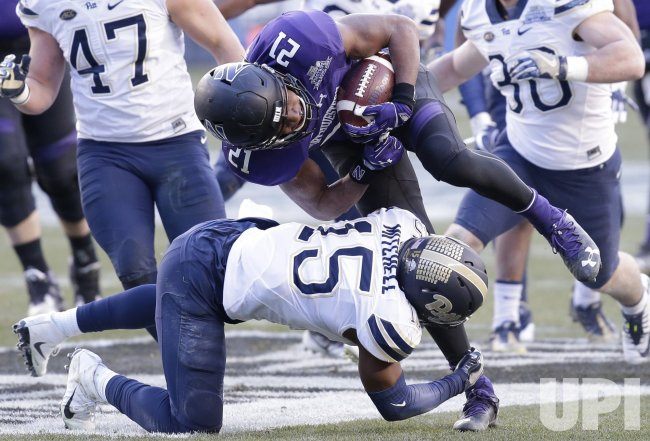 Pittsburgh Reggie Mitchel tackles Northwestern Justin Jackson