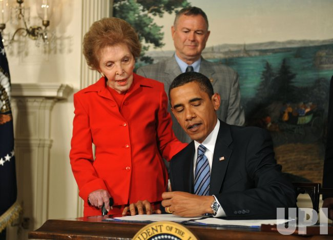 President Obama signs the Ronald Reagan Centennial Commission Act in Washington