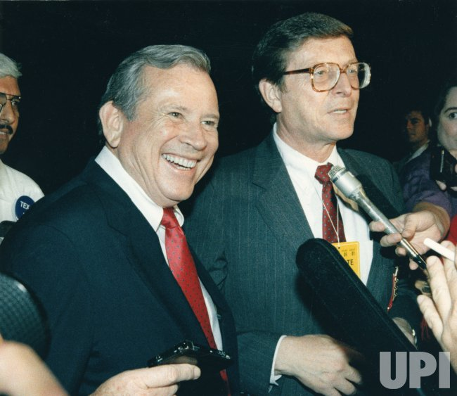 Howard Baker with Pete Domenici face reporters