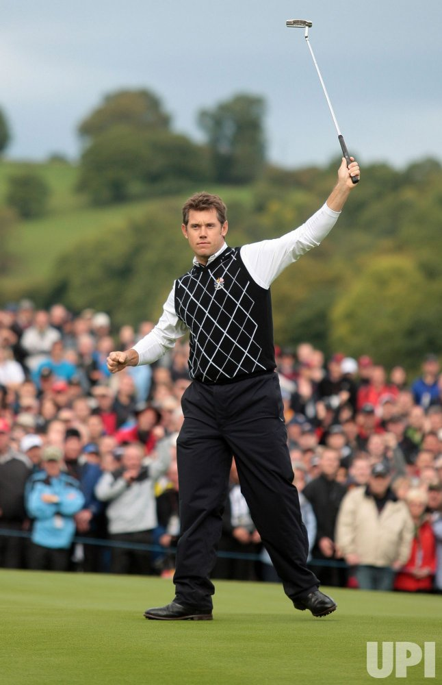 Westwood celebrates putt on the third day of Ryder Cup.