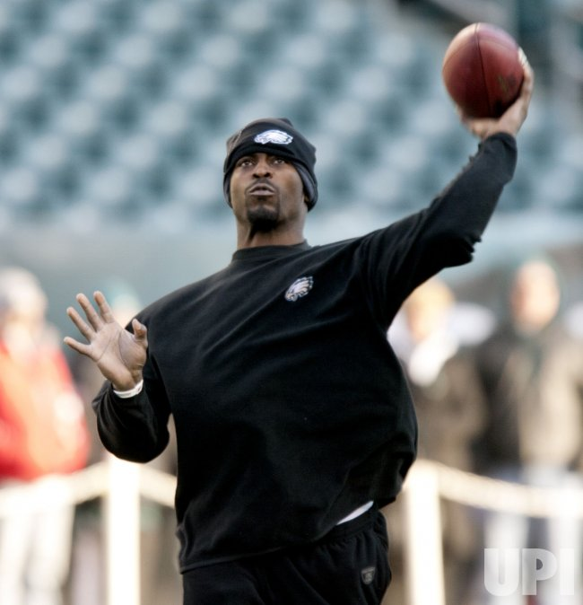 Philadelphia Eagles quarterback Michael Vick makes some practice throws prior to their playoff game with Green Bay.