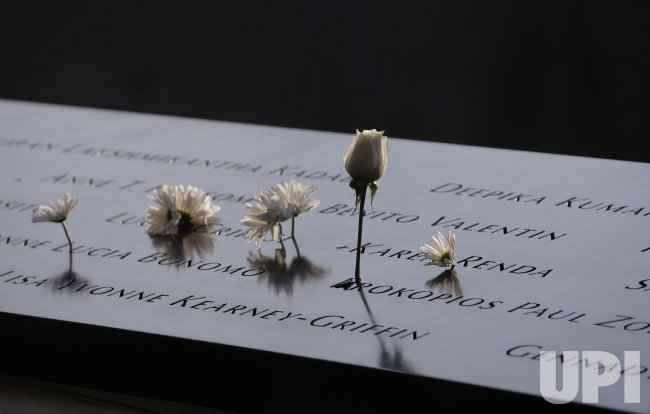 Flowers and names at the Reflecting Pools at 9/11