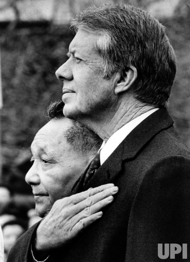 Jimmy Carter and Deng Xiaoping stand at attention for the playing of the national anthems.