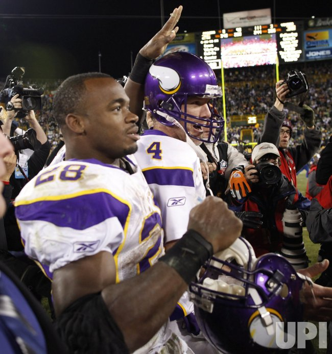 Vikings Peterson and Favre celebrate after beating the Packers