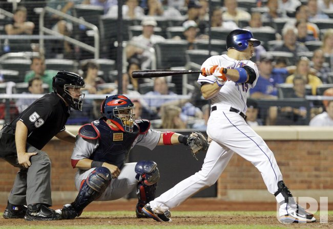 New York Mets Carlos Beltran hits a single at Citi Field in New York