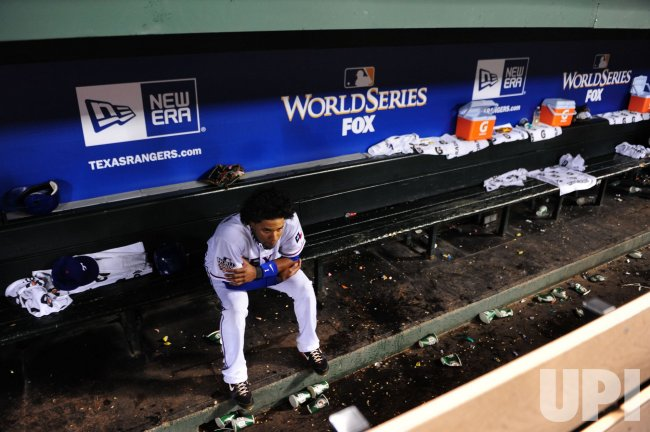 Rangers shortstop Elvis Andrus leaves the dugout after losing the World Series in Texas