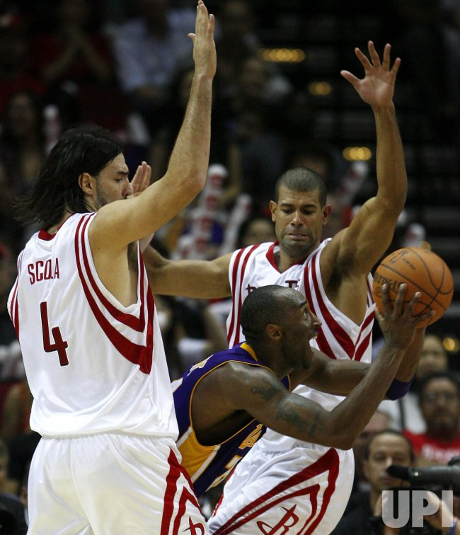 Los Angeles Lakers Kobe Bryant Tries to Shoot Around the Defense of Houston Rockets Luis Scola, of Argentina, and Shane Battier at Toyota Center in Houston