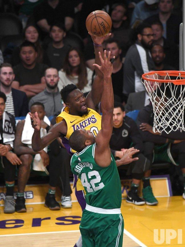 Lakers forward Julius Randle shoots over Celtics center Al Horford (42) at Staples Center
