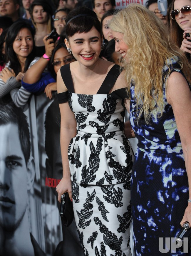 Lily Collins And Mother Jill Tavelman Attend The Abduction Premiere In Los Angeles Upi Com Jill tavelman is a former wife of singer phil collins. lily collins and mother jill tavelman