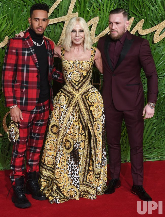 Lewis Hamilton, Donatella Versace and Conor McGregor attend the Fashion Theatre Awards at Royal Albert Hall, London