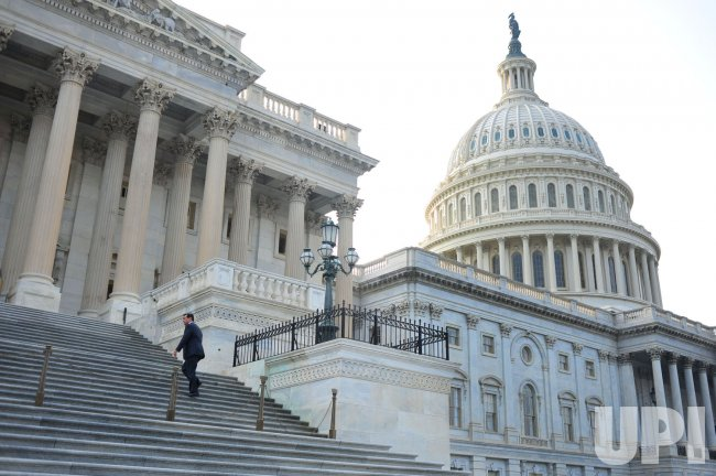Rep. Darrell Issa arrives at the U.S. Capitol to vote on the Budget Control Act of 2011 in Washington