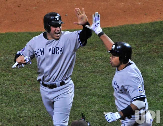 Yankees' Mark Teixeira and Alex Rodriguez celebrate during game 4 of the world series in Philadelphia