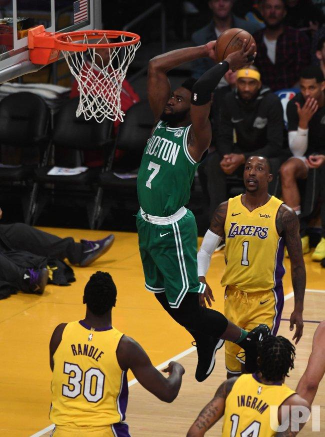 Celtics guard Jaylen Brown dunks over Lakers Julius Randle at Staples Center