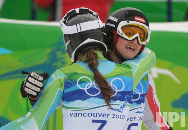 Austria's Elisabeth Goergl hugs Slovenia's Tina Maze during the Women's Giant Slalom in Whistler