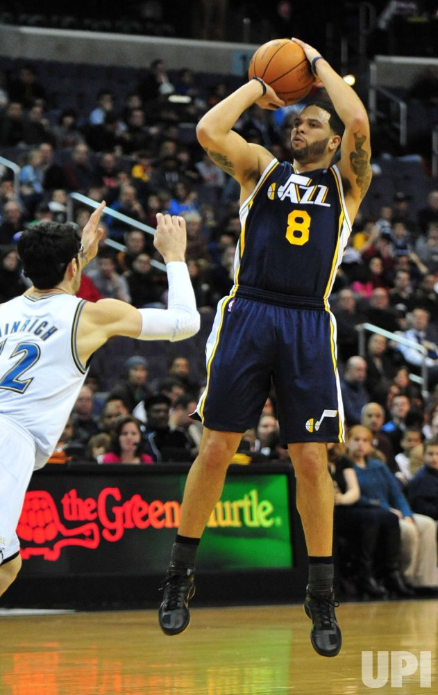 Utah Jazz Deron Williams shoots for three in Washington