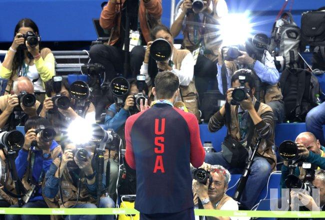 Photographers take photos of Michael Phelps at Rio Olympics