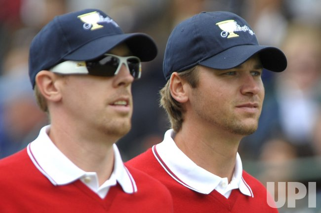 Hunter Mann walks with teammate Sean O'Hair during the first round of the 2009 Presidents Cup in San Francisco