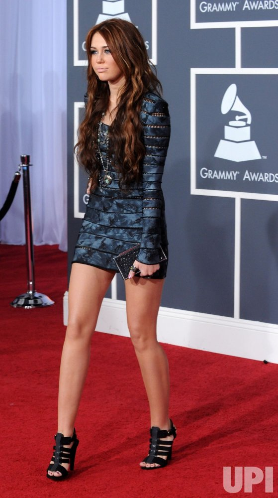 Miley Cyrus arrives at the 52nd annual Grammy Awards in Los Angeles