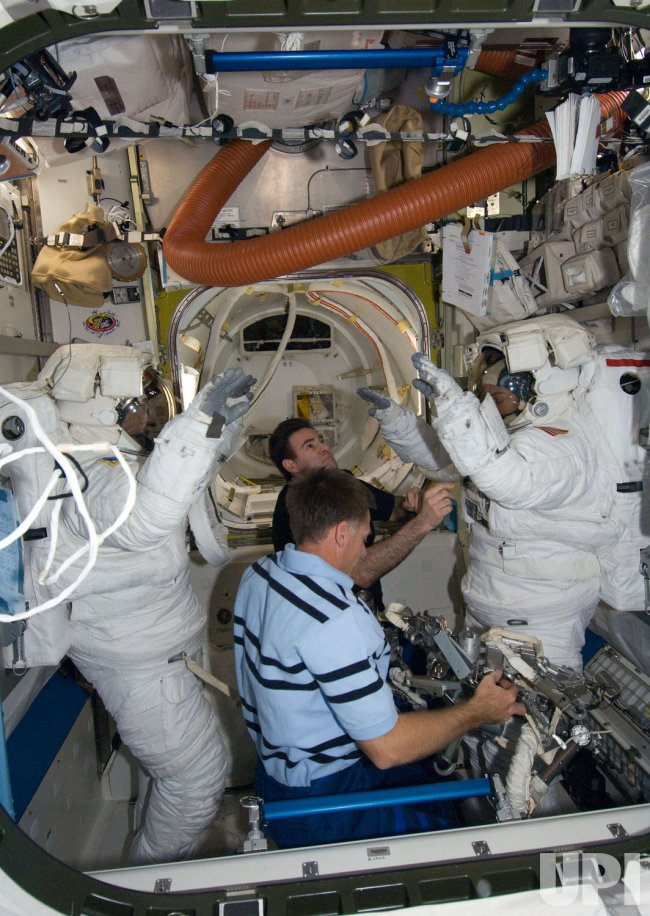 Astronauts conduct the first spacewalk of mission STS-126