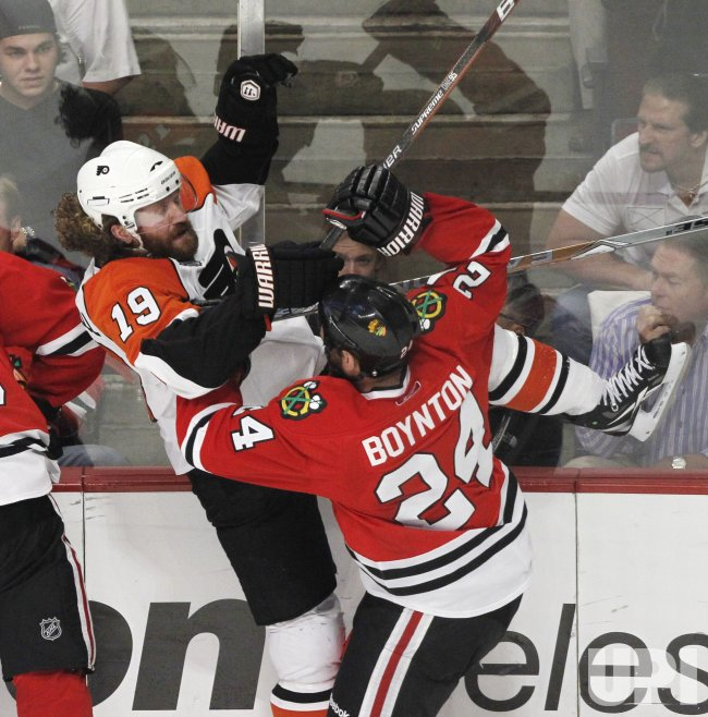 Blackhawks Boynton checks Flyers Hartnell during the 2010 Stanley Cup Final