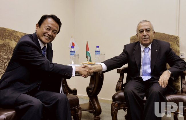 JAPAN AND PALESTINE SIGN FINANCIAL TREATY IN RAMALLAH