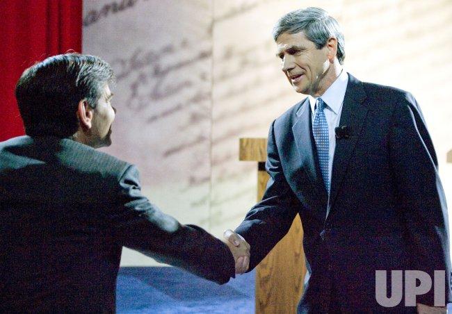 Pennyslvania Senate candidate Joe Sestak greets moderateor ABC News newsman George Stepanopoulos.