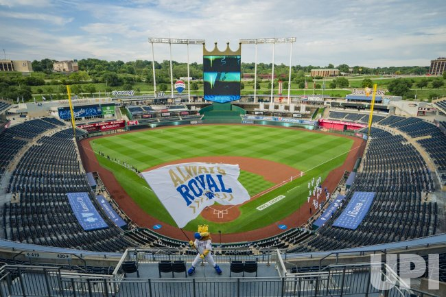 Royals mascot Sluggerrr waves a Royals flag before the game against the White Sox